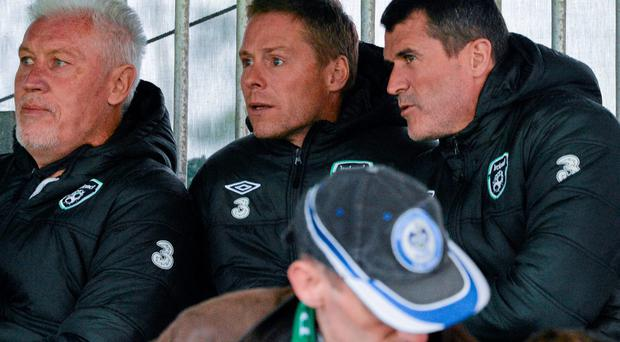 Ireland assistant manager Roy Keane, right, with goalkeeping coach Seamus McDonagh, left, and coach Steve Guppy in attendance at the game