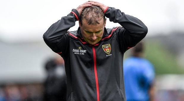 Down manager James McCartan dejected late in last Sunday's game against Tyrone