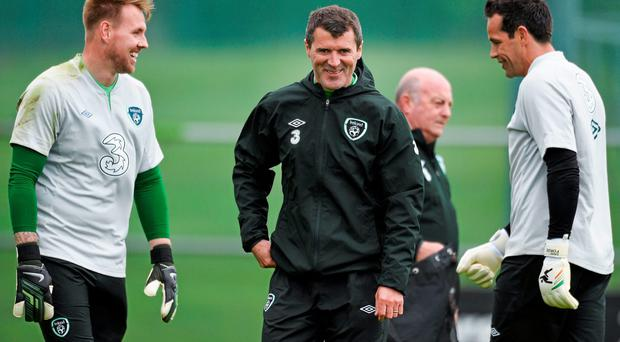 Roy Keane shares a joke with goalkeepers Rob Elliot (left) and David Forde at the Ireland training session at Malahide yesterday. Photo: David Maher / SPORTSFILE