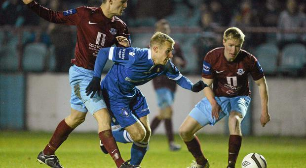 Limerick's Danny Galbraith in action against Drogheda United's Michael Daly, left, and Paul O'Conor