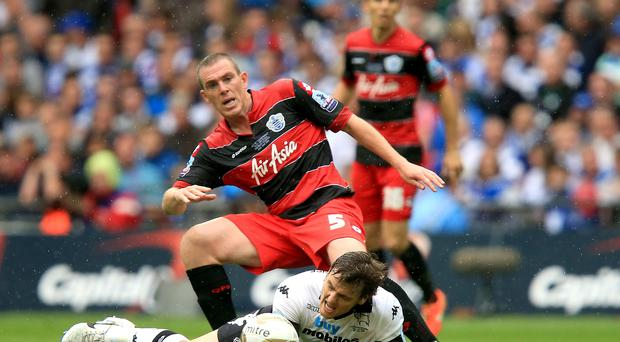 Queens Park Rangers' Richard Dunne (back) battles for the ball with Derby County's Chris Martin during the Sky Bet Championship Play Off Final at Wembley