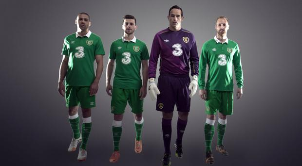 Jonathan Walters, Shane Long, David Forde and David Meyler model the new Republic of Ireland home kit.