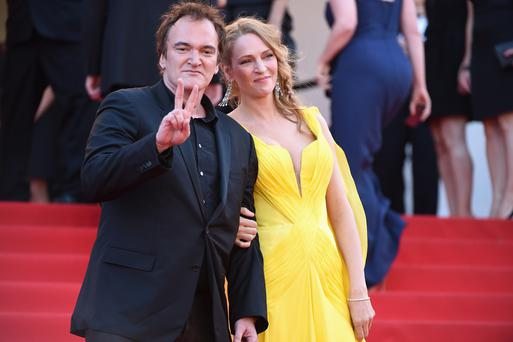 Quentin Tarantino (L) and Uma Thurman attend the