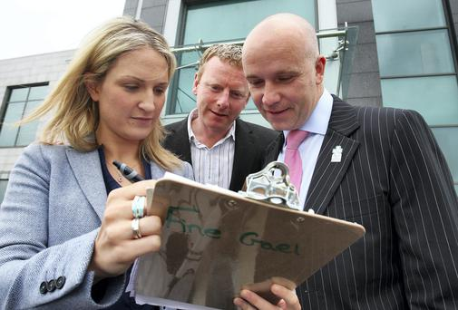 NUMBERS GAME: Helen McEntee, with FG candidates Alan Tobin and David Harford, right, in Navan yesterday. Photo: Tom Burke
