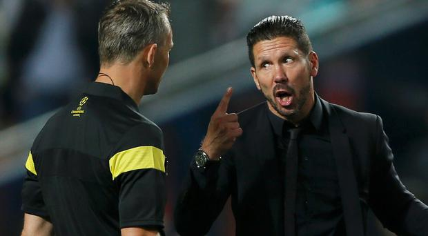 Atletico Madrid's coach Diego Simeone complains to the referee in the Champions League final