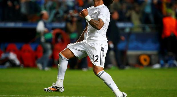 Real Madrid's Marcelo celebrates after defeating Atletico Madrid in the their Champions League final