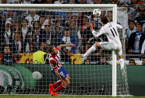 Gareth Bale squeezes a header into the top corner to put Real Madrid ahead in the second-half of extra-time. Photo: REUTERS/Paul Hanna