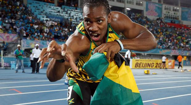 Jamaica's Yohan Blake poses for photographers after Jamaica set a new world record in winning the 4x200 metres relay at the IAAF World Relays Championships in Nassau, Bahamas
