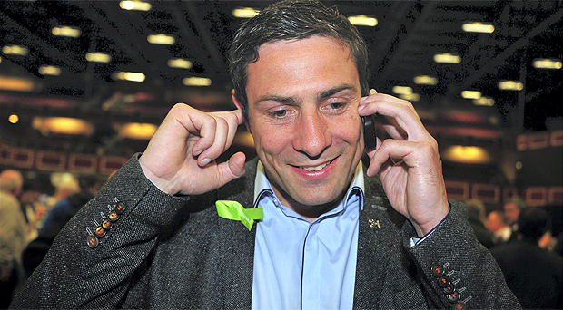 Fine Gael local election candidate, Olympic boxing hero Kenny Egan, takes a phone call from a well wisher as he awaits results at the count centre in City West