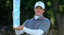 Rory McIlroy poses with the trophy following his victory at the end of day four of the BMW PGA Championship at Wentworth