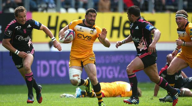Andrea Masi of Wasps attacks during the European Rugby Champions Cup Play-off match between Stade Francais Paris and London Wasps at Stade Jean-Bouin in Paris, France