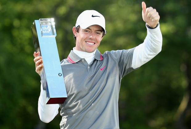Rory McIlroy poses with the PGA Championship trophy