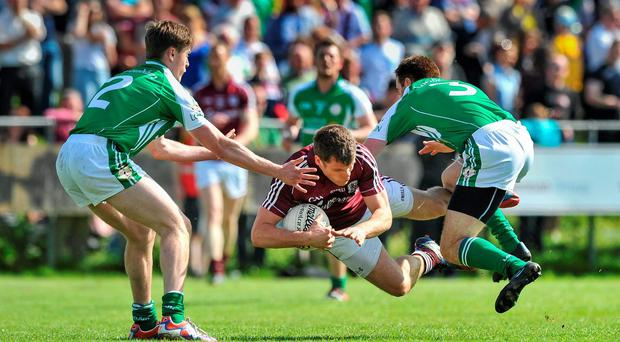 Eddie Hoare, Galway, in action against Philip Butler and Stephen Curran, London. Connacht GAA Football Senior Championship, Quarter-Final, London v Galway, Emerald Park, Ruislip, London, England