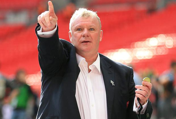 Rotherham United manager Steve Evans celebrates with his winner's medal after the League One play-off final at Wembley