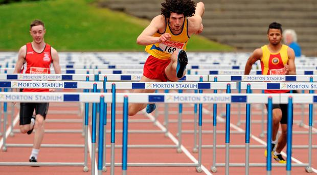 Ben Reynolds, North Down A.C., on his way to winning the Mens 110m Hurdles event. The 2014 AAI Games. Morton Stadium, Santry, Co. Dublin