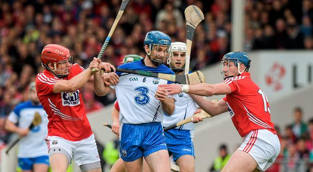 Michael Walsh, Waterford, in action against Bill Cooper, left, and Patrick Horgan, Cork. Munster GAA Hurling Senior Championship, Quarter-Final, Cork v Waterford, Semple Stadium, Thurles, Co. Tipperary.