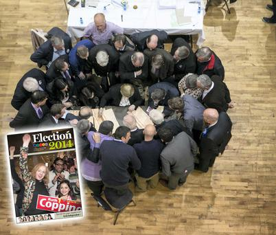 Party representatives check spoilt votes at the count in Castlebar, Mayo. Photo: Kyran O'Brien