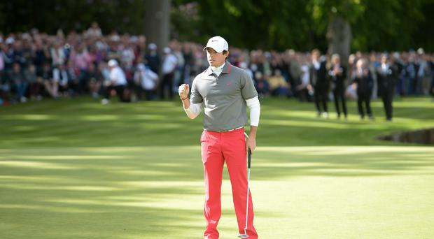 Rory McIlroy celebrates at the 18th after his birdie to win the BMW PGA Championships the Wentworth Club
