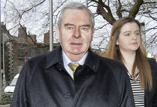 Bankrupt businessman Sean Quinn outside the Criminal Courts of Justice with his daughter, Brenda Quinn.