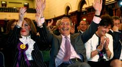 UKIP leader Nigel Farage celebrates European election results with candidates in Southampton, Hampshire. Reuters