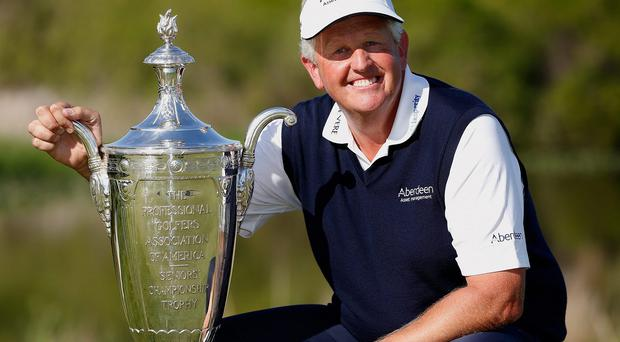 Colin Montgomerie of Scotland poses with the Alfred S. Bourne Trophy after winning the 2014 Senior PGA Championship