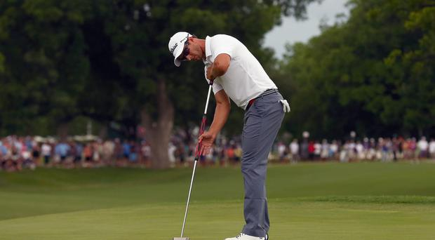 Adam Scott of Australia lines up a birdie putt on the 18th hole during the Final Round of the Crowne Plaza Invitational