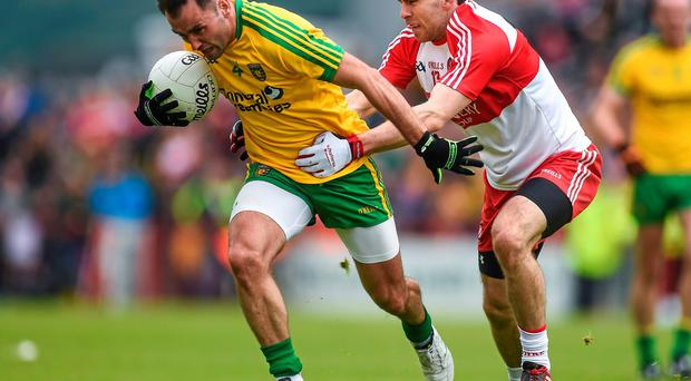 Donegal's Karl Lacey brushes off Derry's Benny Heron during Sunday's Ulster SFC quarter-final at Celtic Park in Derry
