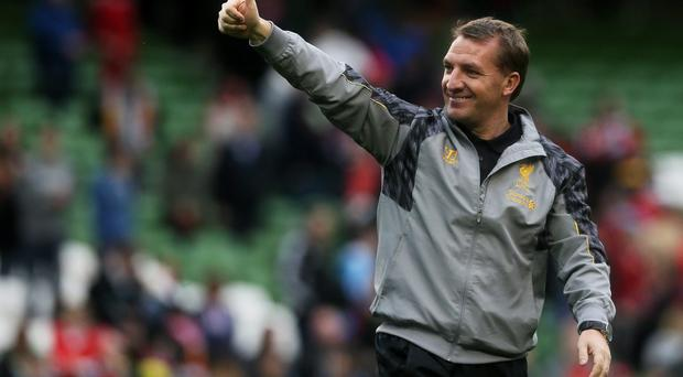 Manager Brendan Rodgers has signed a new long-term contract with Liverpool, the club have announced