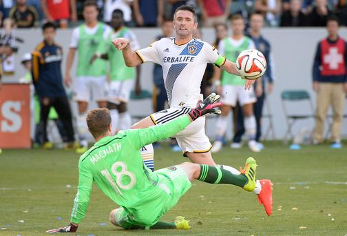 Robbie Keane of Los Angeles Galaxy attempts a shot over Zac MacMath of Philadelphia Union during a 4-1 Galaxy win at StubHub Center in Los Angeles, California. (Photo by Harry How/Getty Images)