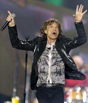 Mick Jagger of The Rolling Stones performs on stage at Telenor Arena during the On Fire Tour 2014