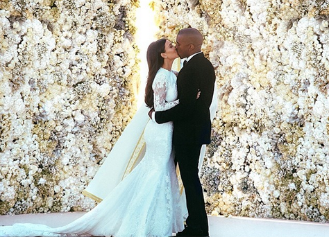 Kim and Kanye share a romantic moment at their wedding.