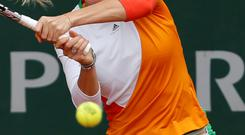 Denmark's Caroline Wozniacki returns the ball to Belgium's Yanina Wickmayer during the first round match of the French Open tennis tournament at the Roland Garros stadium, in Paris, France. (AP Photo/Darko Vojinovic)