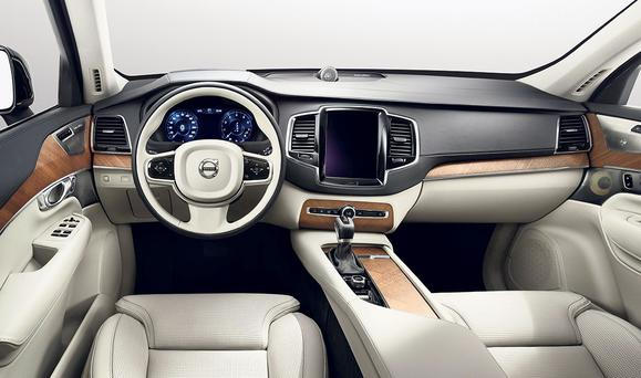 The new Volvo XC90 features leather on the dash and door panels.