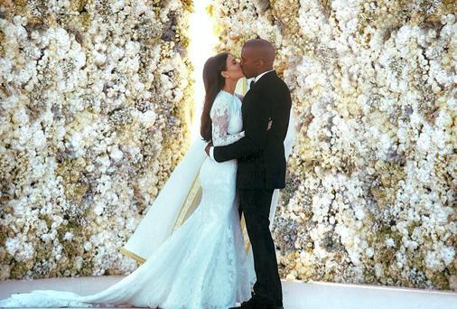 Kanye West and Kim Kardashian share a kiss at their wedding