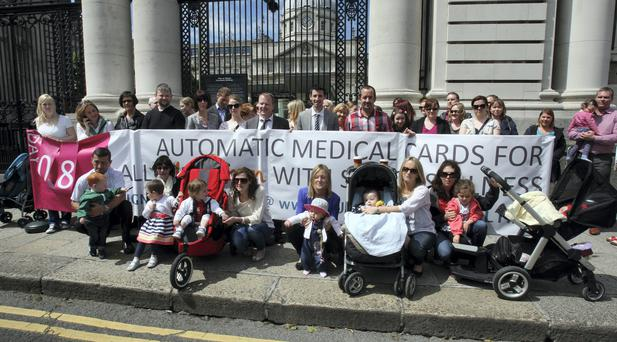 Parents and supporters of the Our Children's Health campaign protest at Government Buildings earlier this week. Picture: Tom Burke