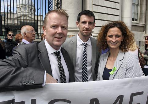 Kevin Shorthall (left) and Peter Fitzpatrick,co-founders of ' Our Children's Health' campaign with Lynn Boylan,MEP at the Our Children's Health campaign protest at Government Buildings yesterday. Picture: Tom Burke