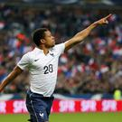 France's Loic Remy celebrates after scoring the third goal during their international friendly against Norway at the Stade de France Stadium in Saint-Denis, near Paris