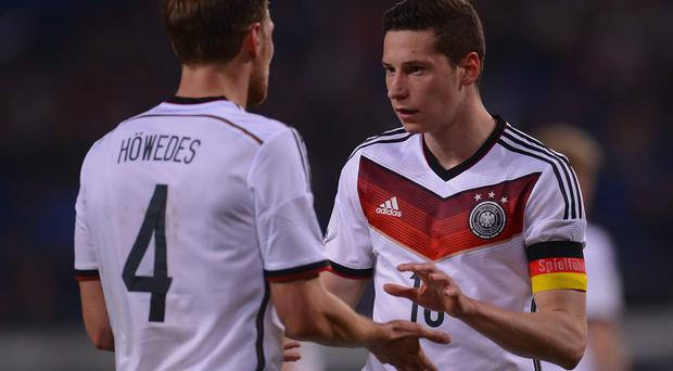 Julian Draxler and Germany teammate Benedikt Hoewedes escaped injury in the car crash. Photo: Lars Baron/Bongarts/Getty Images