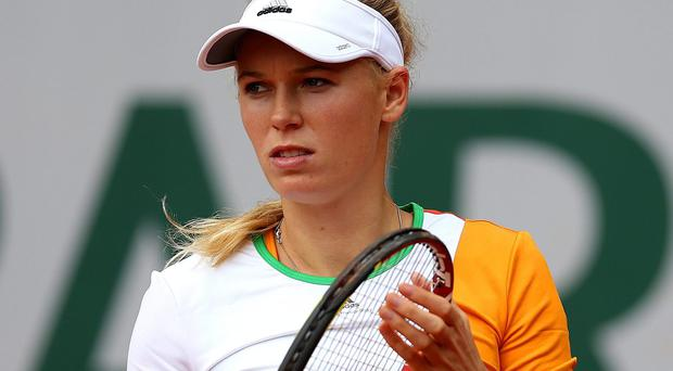 Caroline Wozniacki exited the French Open at the first round yesterday, but the defeat will allow her to step out of the spotlight after what has been a difficult week. Photo: Matthew Stockman/Getty Images