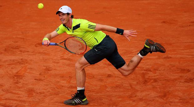 Andy Murray returns a shot during his victory over Andrey Golubev in the first round of the French Open in Paris. Photo: Clive Brunskill/Getty Images