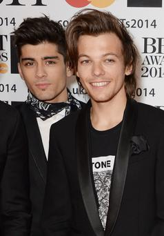 LONDON, ENGLAND - FEBRUARY 19: Zayn Malik (L) and Louis Tomlinson of One Direction attend The BRIT Awards 2014 at the 02 Arena on February 19, 2014 in London, England. (Photo by David M. Benett/Getty Images)
