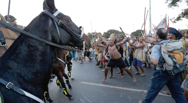 Indians clash with military police during a protest against the FIFA World Cup outside the National Stadium in Brasilia, Brazil