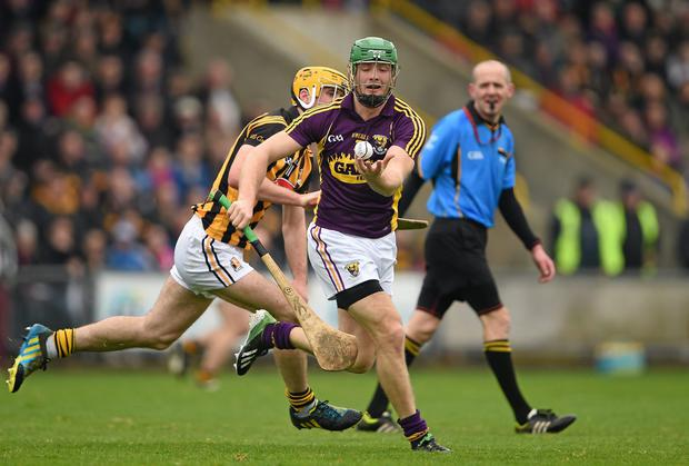 wexford captain matthew ohanlon here in action against kilkennys colin fennelly is
