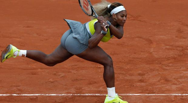 Serena Williams of the U.S. returns the ball during the second round match of the French Open tennis tournament against Spain's Garbine Muguruza at the Roland Garros stadium, in Paris, France. Williams lost in two sets 2-6, 2-6. (AP Photo/Darko Vojinovic)