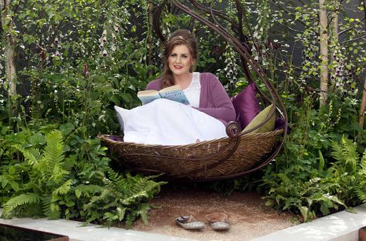 Emma Laura Skelton from Drogheda takes it easy at the Samaritans' garden. Photo: Collins
