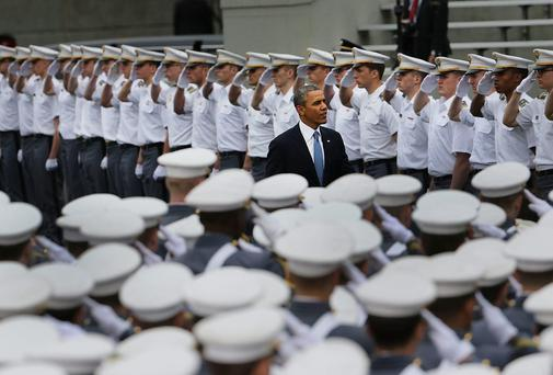 U.S. President Barack Obama enters the stadium at West Point to give the commencement address at the graduation ceremony at the U.S. Military Academy in West Point, New York. In a highly anticipated speech on foreign policy, the President provided details on his plans for winding down America's military commitment in Afghanistan. Over 1,000 cadets are expected to graduate from the class of 2014 and will be commissioned as second lieutenants in the U.S. Army