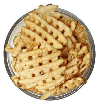 Bowl of Waffle Fries Over White
