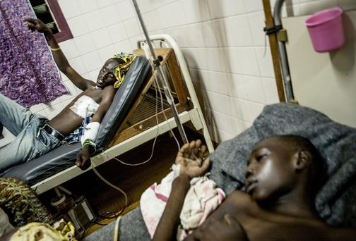 Wounded patients receive medical care in the ward of the Community Hospital in Bangui