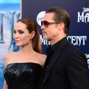 "Actors Angelina Jolie (L) and Brad Pitt attend the World Premiere of Disney's ""Maleficent"" at the El Capitan Theatre"