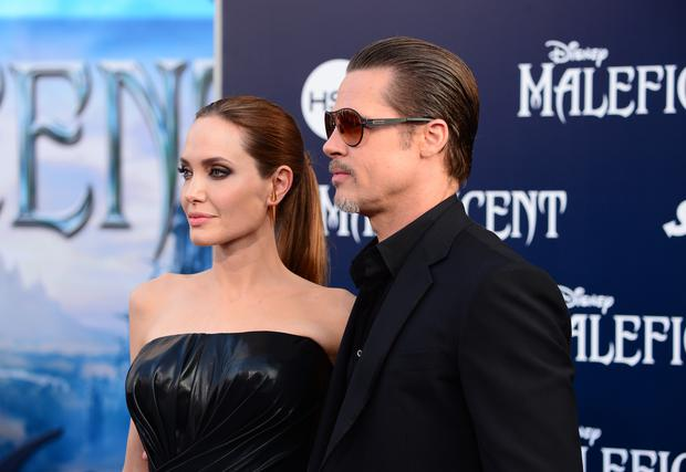 Actors Angelina Jolie (L) and Brad Pitt attend the World Premiere of Disney's